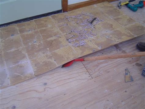removing ceramic tile flooring backerboard base