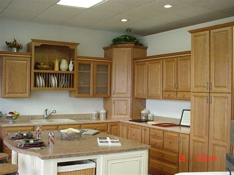 wellborn forest oak cabinets in spice with accent island in vanilla bean paint our