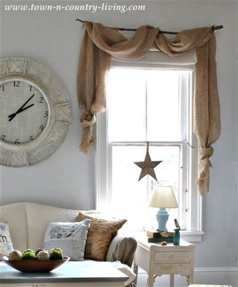 country decorating style in a farmhouse family room curtain swags made from landscape burlap