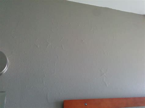 paint with hairline cracks all bathroom drywall