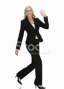 Happy Businesswoman Walking and Waving Her Hand Stock ...