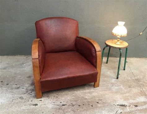 ancien fauteuil style club en bois et simili cuir