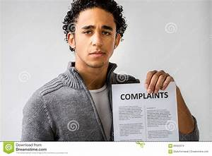 Young Man Holding Complaints Report Stock Photo - Image of ...