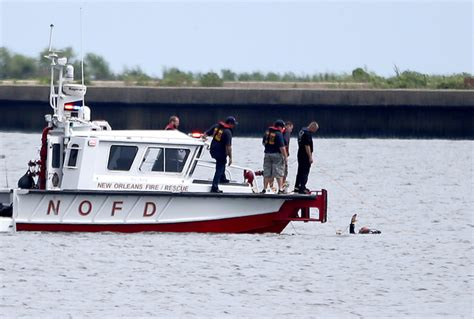 New Orleans Fire Boat by Crews To Retrieve Plane From Lake 2 Men Still Missing