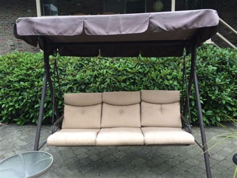 fred meyer patio swing canopy replacement and cushions available refurbish your patio swings