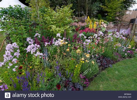 A Colourful Mixed Flower Border In A Cottage Garden Stock