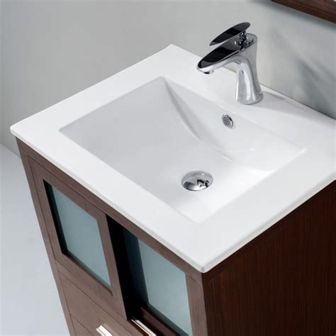 attractive bathroom vanity with top mount sink and moen contemporary faucets above small sliding