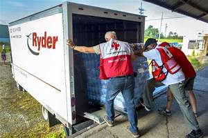 American Red Cross Workers Load Disaster Relief Items Onto ...
