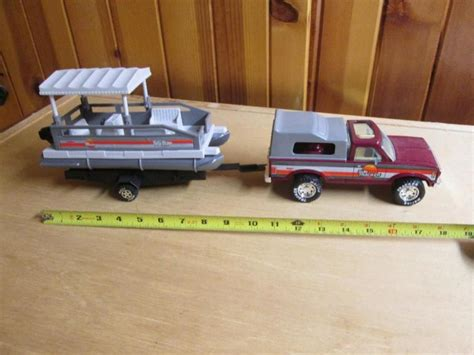 Toy Fishing Boat And Trailer by Nylint Sun Tracker Truck W Cer Shell Pontoon Boat