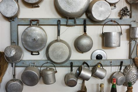 hook pots and pans on the wall 9 ingenious space saving kitchen solutions popsugar food