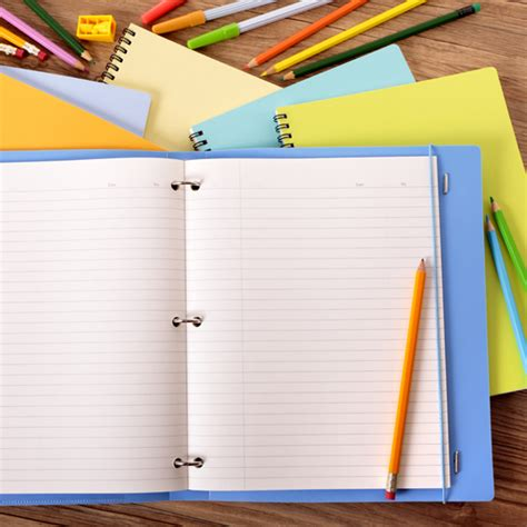 Open Notebook With Color Pencils Photo  Free Download