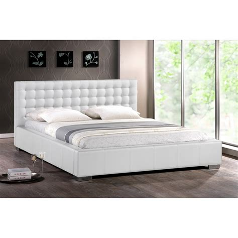 white modern bed with upholstered headboard king