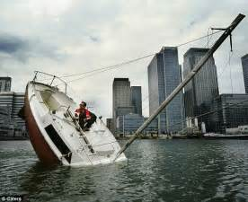 Pictures Of Sinking Boats by French Designer Julien Berthier Travels The Globe In