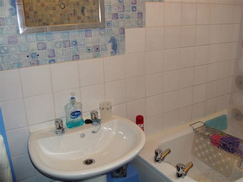 bathroom retiled around bath and sink area tiling in
