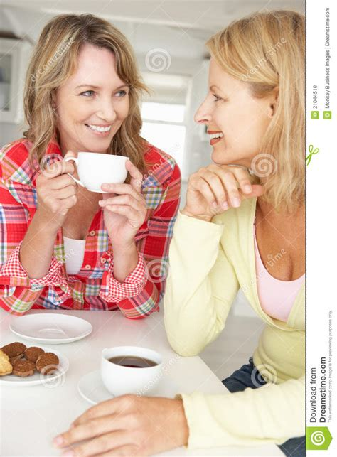 Mid Age Women Chatting Over Coffee At Home Stock Photo   Image: 21044510