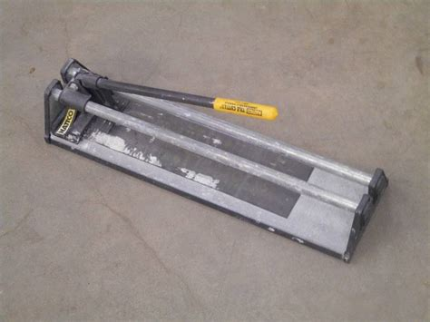 nattco tile cutter loretto equipment 288 k bid