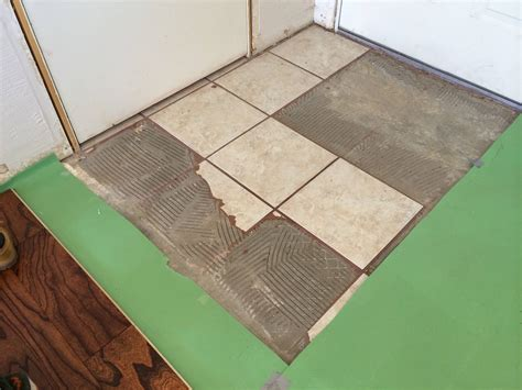 demolition what is the right way tool to remove this tile and thinset from a concrete slab