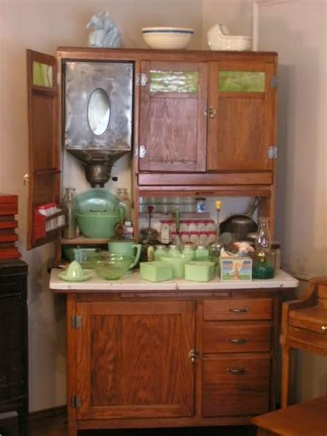 a hoosier cabinet by boone circa 1910 with typical late kitchen implements both