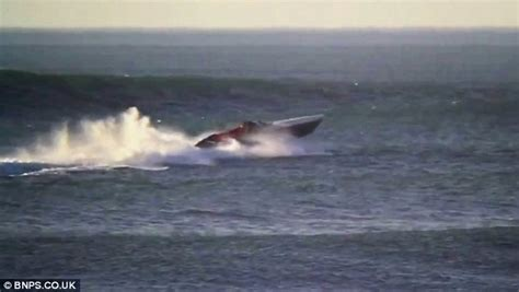 Driving Boat In Waves by Dramatic Moment A 163 600k Powerboat Is Flung 40ft Into The