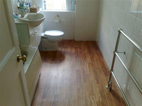 Very Small Bathroom Spaces With Vinyl Wood Plank Flooring