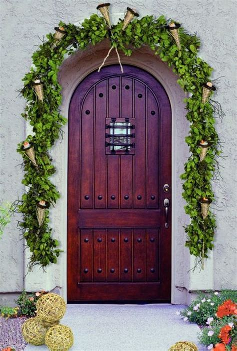 how to decorate your front door for the holidays the lovely look of simple festivity