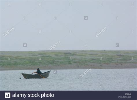 Rowboat In The Rain by Rowboat Fog Lake Stock Photos Rowboat Fog Lake Stock