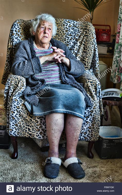 An Old Lady Sitting In A Chair Stock Photo, Royalty Free