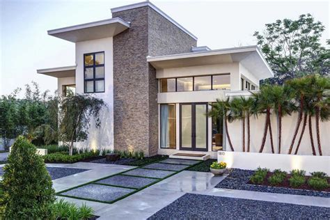 Modern Front Yard Landscaping Planted With Ornamental
