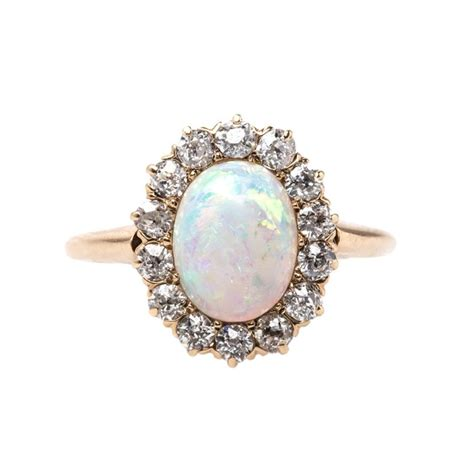 Dragon's Breath Opal Engagement Rings  Opal Engagement. Elizabeth Rings. Guitar Rings. Model Engagement Rings. Anna Paquin's Wedding Rings. Fine Engagement Rings. Heart Rings. Olive Skin Wedding Rings. Mountain Inspired Wedding Wedding Rings