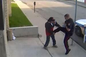 Shocking moment police officer kicks homeless man causing ...