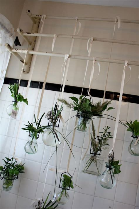 plants in bathroom front windows and vases on
