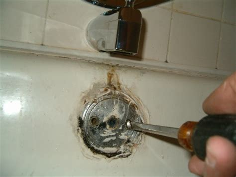how to replace a bathtub drain overflow assembly step 1