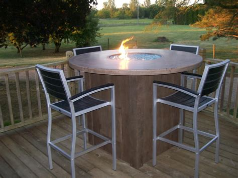 concrete table with pit and wooden like base