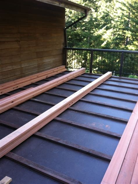 ib waterproof membrane with 2x4 pt sleepers and 2x6 redwood ch decking other