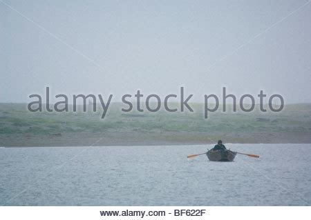 Rowboat In The Rain by Rowing In The Rain Stock Photo 14659613 Alamy