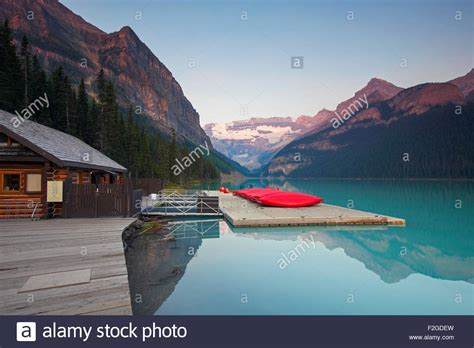 Canoes Victoria by Red Canoes At Glacial Lake Louise With Victoria Glacier