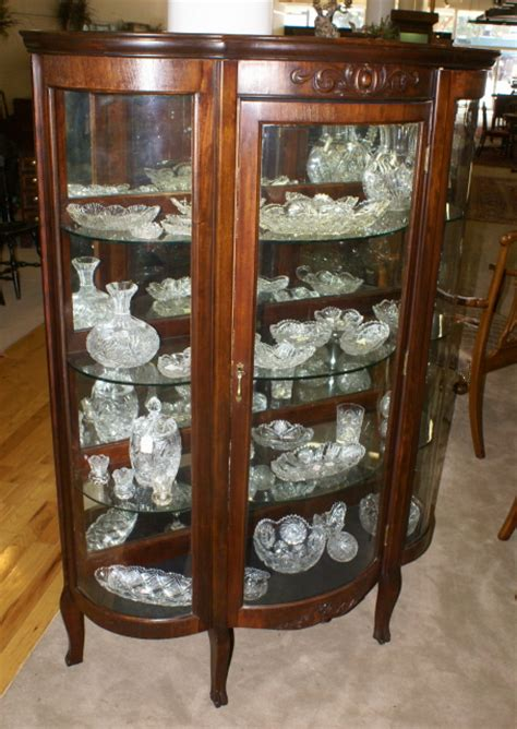 Walnut triple bow front antique china cabinet