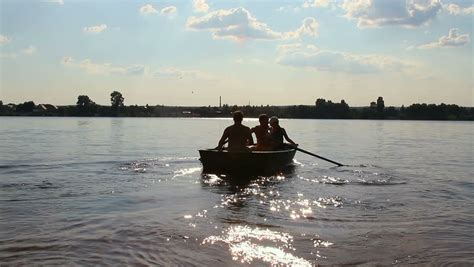 People On A Boat by Rowboat Stock Footage Video Shutterstock