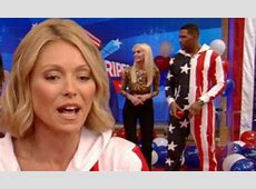 Kelly Ripa and Michael Strahan don USA flag onesies for