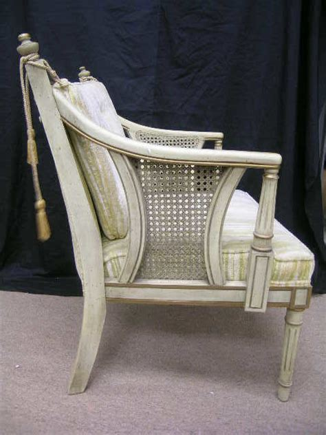 565 statesville chair co rattan sided arm chair lot 565