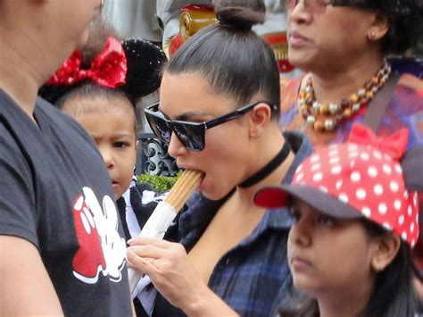 Gets A Mouthful At Disneyland