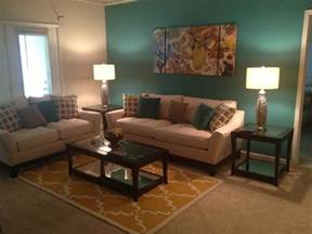 brown and teal living room designs teal and yellow living room with sectional sofa and white